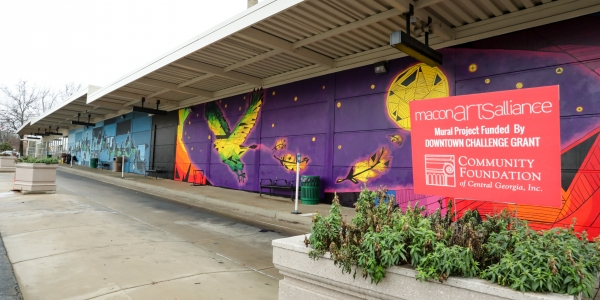 Multiple local artist mural project funded by the Downtown Challenge located next to Terminal Station